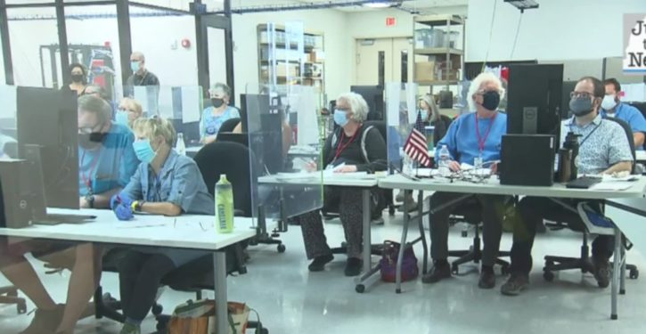 Poll workers told to leave, then suitcases full of ballots pulled out