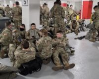Troops in Capitol complex moved from floors inside to parking garage for rest periods