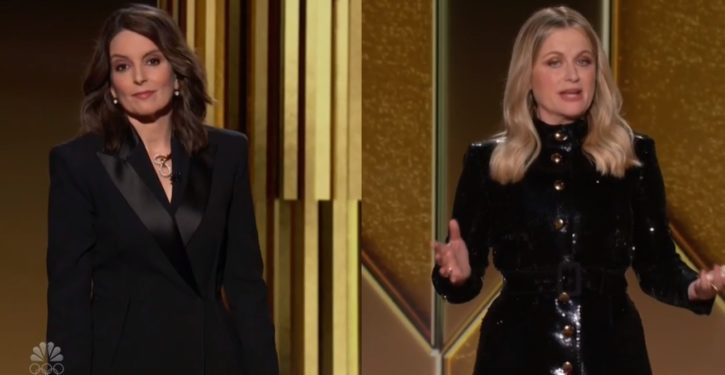 Tina Fey breaks promise of politics-free Golden Globes in first few minutes of broadcast