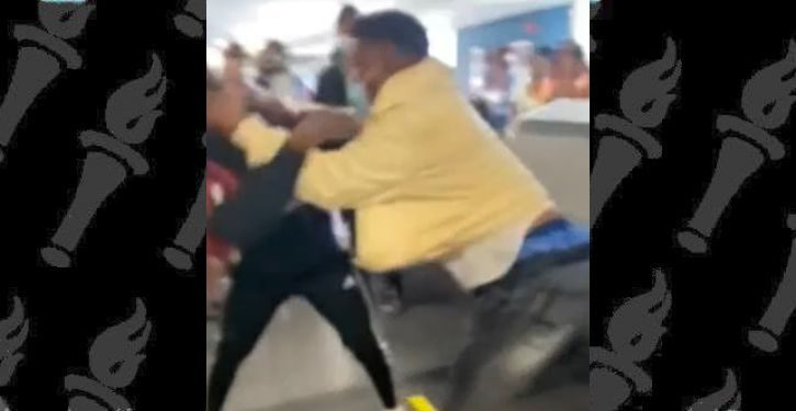 Another massive brawl breaks out at Miami Int'l Airport, this time over masks