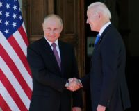 Biden and Putin showdown begins with awkward photo op