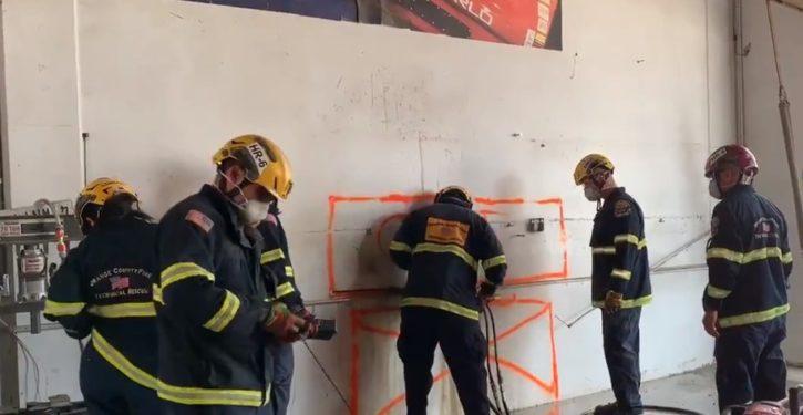 Crews rescue naked woman wedged between 2 buildings in Calif. city