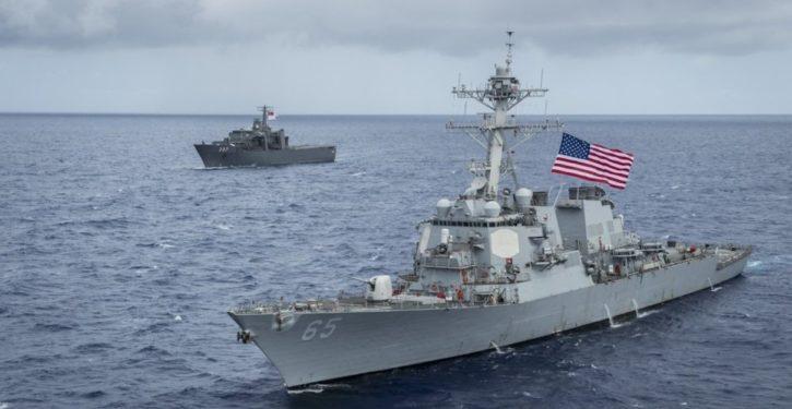 China says 'drove away' U.S. warship in S. China Sea; U.S. says routine interaction