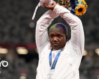 U.S. shot-putter who defied protest ban should walk a mile in fellow Olympian's shoes