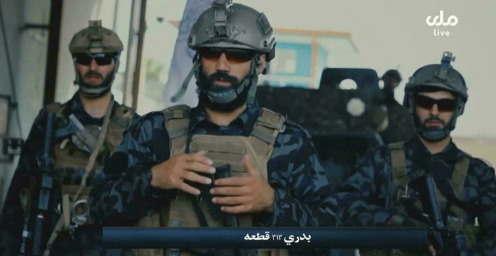 Dressing up in Daddy's clothes: Taliban don left-behind 'special forces' gear for photo op
