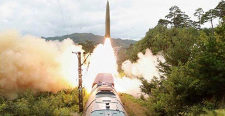 North Korea launches missiles toward Japan; posts photos of trainborne launch