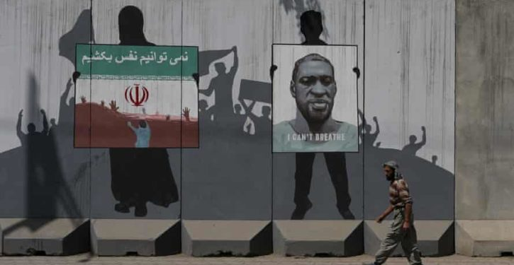 The Taliban has painted over a George Floyd mural